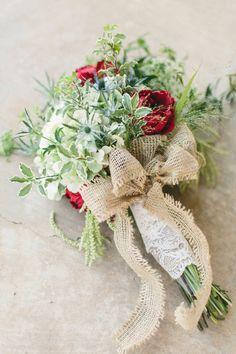 wildflower bouquet tied with burlap and lace, photo by Mint Photography http://ruffledblog.com/backyard-brownwood-wedding #weddingideas #flowers #rusticwedding