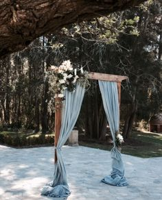 dusty blue grey hand dyed linen draping on rustic timber arbor at Circa 1876 Hunter Valley