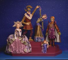 Masked Ball: mechanical display based on Venetian Carnival and other midwinter celebrations. The Masked Lady removes a happy brightly painted face to reveal the shy pale Wallflower beneath, the male Dancer twirls the female Dancer who surprises us by becoming a completely different person as she rotates (Black lady, White Lady), while the Turkish Prince bows, and little Cupid seeks a likely target for his arrows.