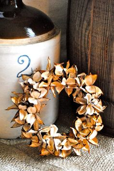Cotton burr wreath...  http://www.etsy.com/listing/82598464/cotton-bur-wreath-candle-ring-home-decor