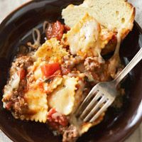 Baked Beef Ravioli Recipe ~ Layers of ravioli noodles, ground beef, diced tomatoes, herbs, and shredded cheese bake together for a quick and flavorful supper your family will love.