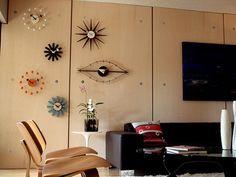 Wall of Mid century Mod clocks. love it!