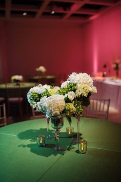Green and white centerpiece // Photo by http://puresugarstudios.com, see more: http://theeverylastdetail.com/elegant-hot-pink-and-green-wedding/