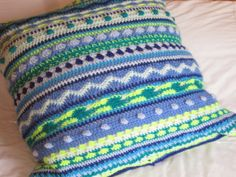 Made Out Of Things: Blankets, blankets everywhere... Blue and Green Multi Stitch Cushion Cover.  Link to various Stitch Patterns.