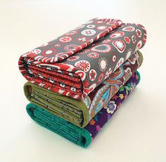 DIY - The wallet that fits everything! Check out these three wallets made from a sewing pattern from NapkittenPatterns.