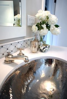 Tamara Mack Design - bathrooms - hammered sink, hammered bathroom sink, mercury glass tumbler, mercury glass vase, marble tile backsplash, marble backsplash, white framed mirror, chic bathroom, elegant bathroom, oval sink, mercury glass bathroom accents, mercury glass, hammered metal sink,