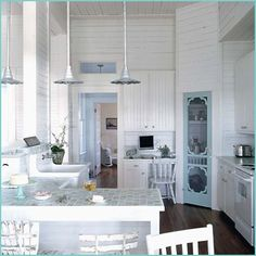 adorable kitchen! Love all the white wood boards!