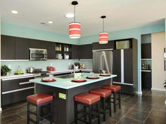 Red Kitchen Design: Color and form blend perfectly to create an iconic version of cool kitchen design. From HGTVRemodels.com
