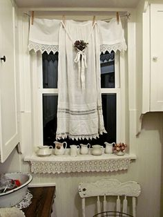 Love the antique linens for curtains..