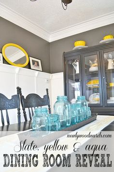 A dining room tour in lovely slate, yellow and aqua - you have to see  the ugly before photos (red and green walls and layers of bad tile).