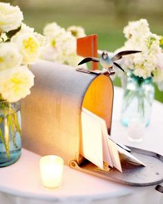 Old mail box set up for guests to drop off cards for a wedding. Love this idea!