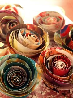 Paper roses made from recycled magazine pages.