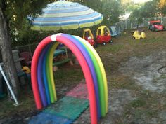 fun rainbow run through arch made from pool noodles!!  (planning to add more to make it longer)