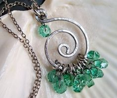 Hammered sterling silver spiral teal blue green faceted glass necklace - Holiday accessories - handmade jewelry. $45.00, via Etsy.