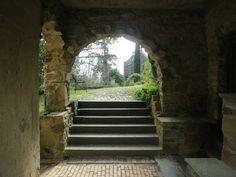 View through an archway at Montsalvat in Eltham, Victoria, Australia