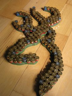 Recycled shotgun shell art Browning hunting deer wall hanger art. Initial instead?