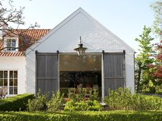 barn style architecture - would love the doors on three sides - so would act like a tent for an outdoor wedding venue.