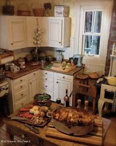 Fabulous Kitchen by Kathleen Holmes with Roasted chicken made by Eleonora Ansano/Eleonora's Dolls House Creations by Eleonora Ansano. Two of Kim Marshall Saulter's apple pies are in the background along with an apple pie prep board made by Crown Jewel Miniatures.
