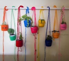 CROCHET plant holders // These are really pretty and could make some amazing indoor plant decorations. Or you wouldn't necessarily have to use plants in the pots... Fill with sculptures in each pot, or something like that.