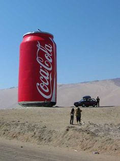 A bunch of big Coke cans.