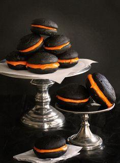 Halloween inspired black velvet whoopie pies with orange marshmallow filling!