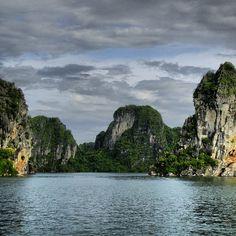 Limestone cliffs in Halong Bay, Vietnam. Photo courtesy of bucketlistbums on Instagram.
