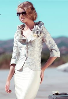 A really flattering mother of the bride outfit from Carla Ruiz, style 86261.
