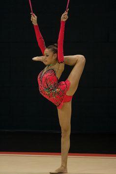 Rhythmic gymnast Yevgeniya Olegovna Kanayeva performing clubs (2008).