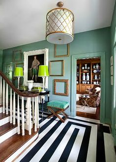 love the graphic painted floors, and the green-teal color palette!