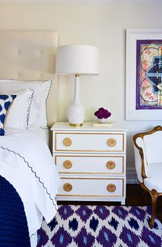 Love the side table also those scalloped edge pillows are to die for