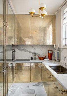 http://erikabrechtel.com/wp-content/uploads/2013/08/gold-cabinets-kitchen-white-carerra-marble-counter-backsplash-floor-Jean-Louis-Deniot.jpg