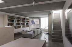 nice space. shot taken from kitchen/dining area. concrete stairs and floors