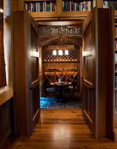 Study bookcases pivot open to reveal a hidden wine cellar...