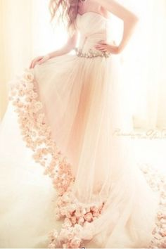 Pale pink wedding dress with a floral trim for the edge of the dress - Beautiful!