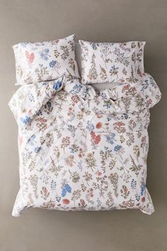 Coordinate your bedding with this duvet set in a delicately blooming floral print. Comes with a duvet cover and pillowcases. Made in a soft weave, the pillowcases feature side slits and the duvet cover features a hidden button closure along edge, to easily remove it all and toss in the wash. Pillows and duvet insert sold separately.Content + Care. Twin XL includes duvet cover and pillowcase Full/Queen includes duvet cover and 2 pillowcases 80% cotton, 20% polyester Machine wash Imported Size Twi