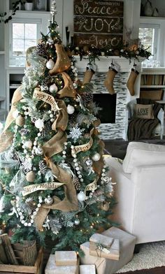 I am in such love with the rustic/shabby chic look of this tree, mantel, and simply everything else.