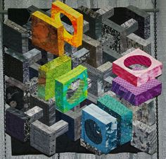 """""""Isometric Perspective"""", 23 x 23"""", by Peggy Thurin (Austin, TX).  2008 AAQG.  Design source:  book """"Isometric Perspectives"""" by Katie Pasquini Mospust."""