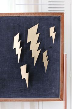 Kablam! Check out this easy DIY metallic lightning bolt mobile!