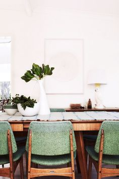 Dining table, dining chairs, white case, white walls