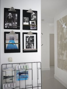 Hang simple black clip boards to display photos and children's art work. Change the photos and art without adding new holes to your walls.