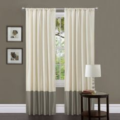 """A great way to extend store bought drapes is by adding a boarder. However the rod here should have extended at least 6"""" wider on each side of the window so that it didn't shroud the view.  The rod could have also been hung as close to the ceiling as possible to elongate the space."""