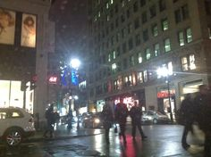 Taken from the back seat of a moving car while it was snowing - a shot of beautiful St. Catherines Street - Montreal, Canada