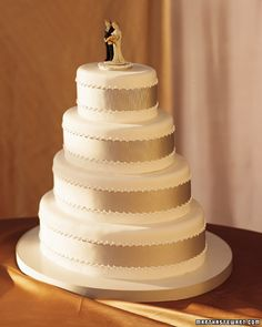 Champagne ribbon wedding cake.