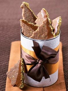 Spruce up an old coffee tin with wrapping paper and ribbon, then fill it with our tasty Chocolate-Pistachio Trees.