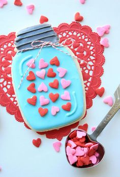 A cute gift for a kid or teacher, these Mason jar cookies are topped off with heart sprinkles and a bit of twine.