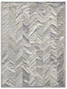 Herringbone patchwork cowhide rug. Gorgeous.