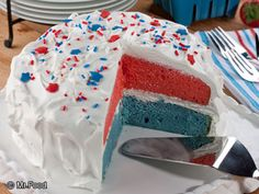 All-American Pudding Cake - This patriotic poke cake recipe is perfect for the Fourth of July, Memorial Day, Labor Day, and more! It's a red, white, and blue dessert that'll be a hit at any potluck or party.