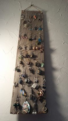 Messy earrings-can't find its match..nails and a weathered piece of wood-now they are on display and easy to find! I love getting organized in the summer!