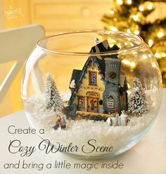 Create a Winter Scene With Lighted House - it's like a big snow globe! So Magical and pretty as a centerpiece. Who says you can't have a white Christmas :)