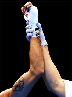 A tattoo of the Olympic Rings is seen on the arm of Jahyn Vittorio Parrinello of Italy after his victory over Jonas Matheus of Namibia on Day 1 of the London 2012 Olympic Games at ExCeL on July 28 2012.